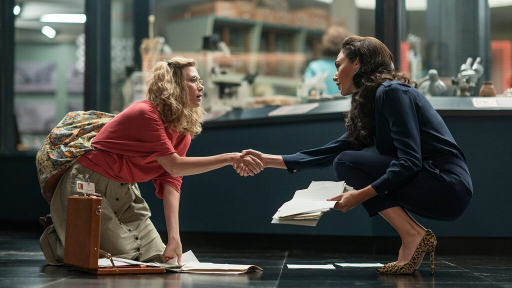 "KRISTEN WIIG as Barbara Minerva and GAL GADOT as Diana Prince in Warner Bros. Pictures' action adventure ""WONDER WOMAN 1984,"" a Warner Bros. Pictures release"