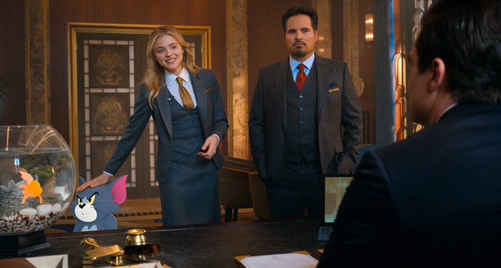 """Tom & Jerry. CHLOË GRACE MORETZ as Kayla, MICHAEL PEÑA as Terrance and ROB DELANEY as Mr. Dubros in Warner Bros. Pictures' animated/live-action adventure """"TOM AND JERRY,"""" a Warner Bros. Pictures release."""